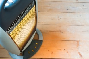Halogen or electric heater on wooden floor