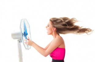 Girl with fan over white