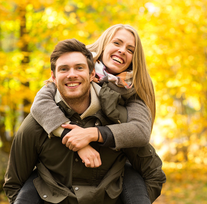 smiling couple having fun in autumn park