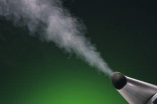 Steam coming out of kettle, green background